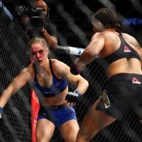 December 30, 2016; Las Vegas, NV, USA; Amanda Nunes lands punches against Ronda Rousey during UFC 207 at T-Mobile Arena. Mandatory Credit: Mark J. Rebilas-USA TODAY Sports
