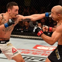 RIO DE JANEIRO, BRAZIL - JUNE 03:  (L-R) Max Holloway punches Jose Aldo of Brazil in their UFC featherweight championship bout during the UFC 212 event at Jeunesse Arena on June 3, 2017 in Rio de Janeiro, Brazil. (Photo by Jeff Bottari/Zuffa LLC/Zuffa LLC via Getty Images)